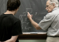 Professor Bard with student at chalkboard